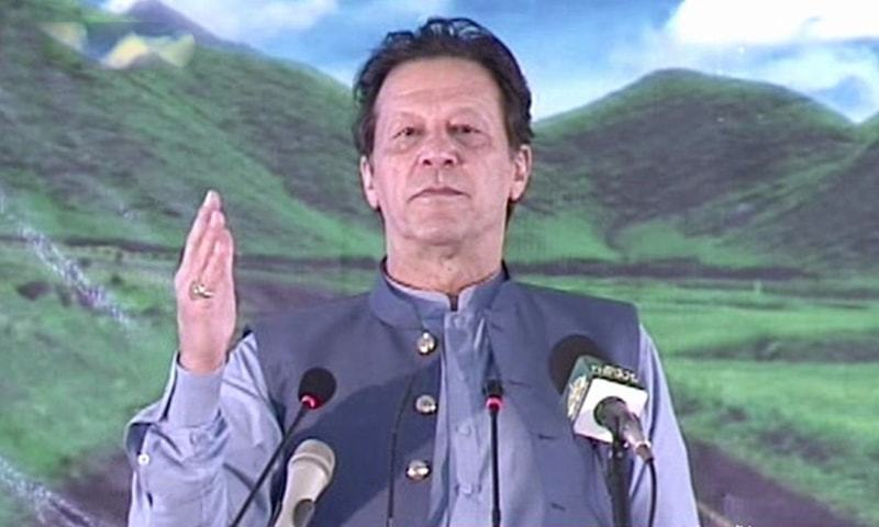 Prime Minister Imran Khan addresses the inauguration ceremony of Nahakki Tunnel and Shaikh Zayed Road in Mohmand on Monday. — DawnNewsTV