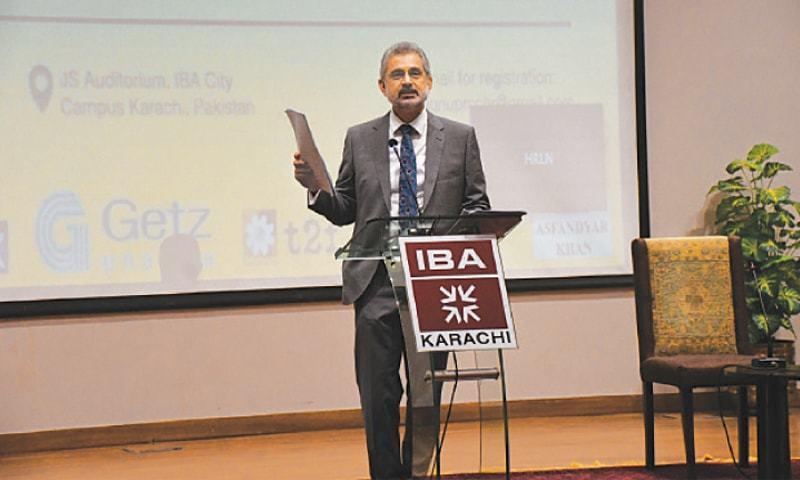 Supreme Court judge Justice Qazi Faez Isa addresses an event at IBA university. — Dawn/File
