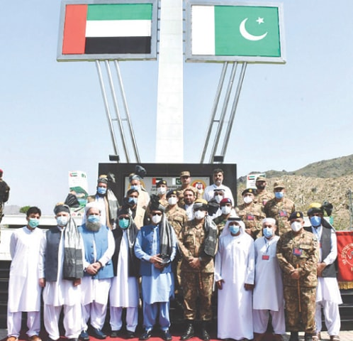 MOHMAND: Prime Minister Imran Khan, Chief of the Army Staff Gen Qamar Javed Bajwa and Ambassador of the United Arab Emirates to Pakistan Hamad Obaid Ibrahim Al-Zaabi pictured with notables of the area after inauguration of Sheikh Zayed Road on Monday.—PPI