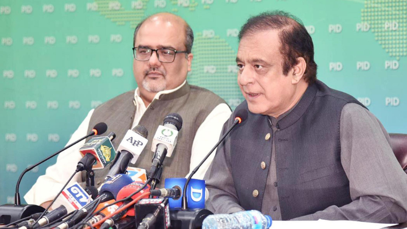 Adviser to the PM on Accountability and Interior Mirza Shahzad Akbar and Information Minister Shibli Faraz address a press conference in Islamabad on Monday. — PID