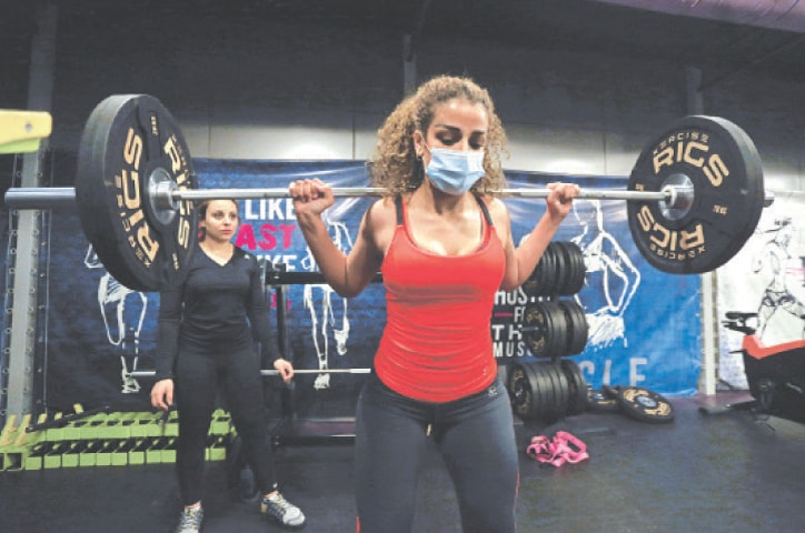A Saudi woman works out at a gym in Riyadh.—Reuters