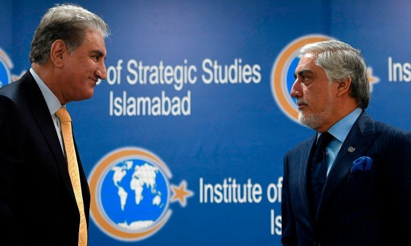 Chairman of the High Council for National Reconciliation of Afghanistan Abdullah Abdullah (R) and Foreign Minister Shah Mahmood Qureshi attend an event at the Institute of Strategic Studies in Islamabad on Tuesday. — AFP