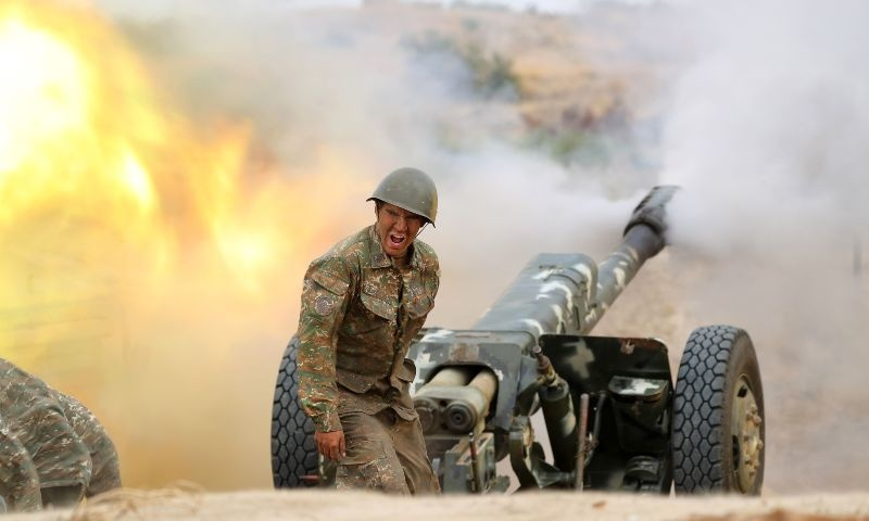 A serviceman of Karabakh's Defence Army fires an artillery piece towards Azeri positions during fighting over the breakaway Nagorny Karabakh region on September 28. — AFP/Armenian Defence Ministry