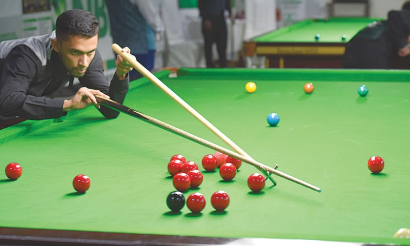 MOHAMMAD Saleem plays a shot against Mohammad Asif Toba at the 12th NBP Ranking Snooker Championship on Tuesday.—Tahir Jamal/White Star