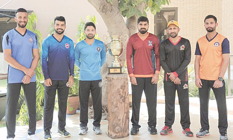 MULTAN: Captains of National T20 Cup teams (from left) Shan Masood (Southern Punjab), Shadab Khan (Northern), Mohammad Rizwan (Khyber Pakhtunkhwa), Haris Sohail (Balochistan), Sarfaraz Ahmed (Sindh) and Saad Nasim (Central Punjab) pose with the trophy on Tuesday.—INP