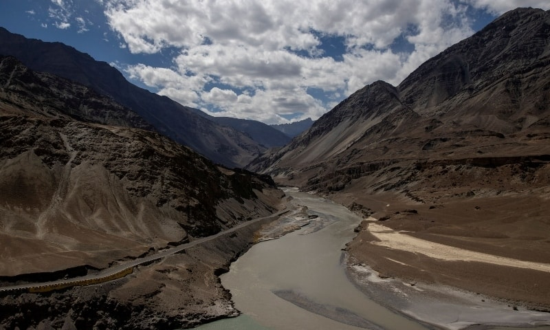 A highway being built by the Border Roads Organisation (BRO) passes by the confluence of the Indus and Zanskhar rivers in the Ladakh region. — Reuters