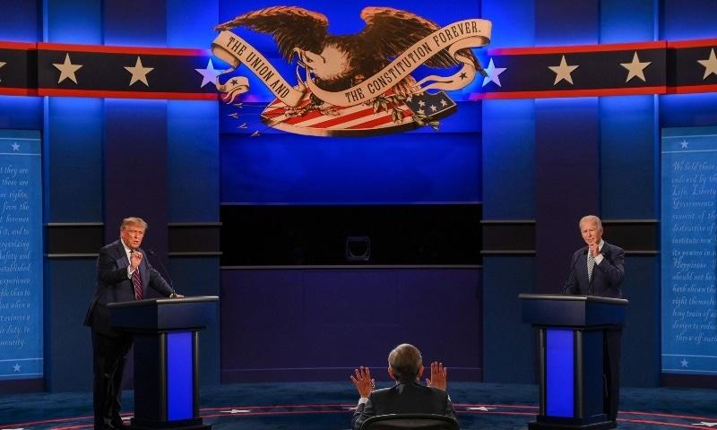 US President Donald Trump and Democratic Presidential candidate and former US Vice President Joe Biden exchange arguments as moderator and Fox News anchor Chris Wallace (C) raises his hands to stop them during the first presidential debate in Cleveland on September 29. — AFP