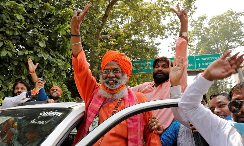 Sakshi Maharaj (in turban), a lawmaker from India's ruling Bharatiya Janata Party (BJP), flashes a victory sign after he was acquitted in a case over the demolition of a mosque at a disputed site 28 years ago, outside a court in Lucknow on September 30. — Reuters