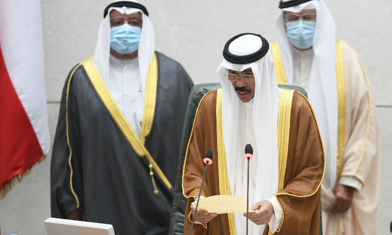 The new Emir of Kuwait Sheikh Nawaf Al Ahmad Al Sabah, middle, recites the constitutional oath at the Kuwaiti National Assembly on September 30. — AP