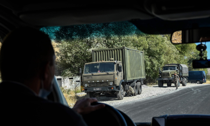 Military trucks are seen on the side of a road near the village of Zangakatun in Armenia on September 30, 2020. — AFP