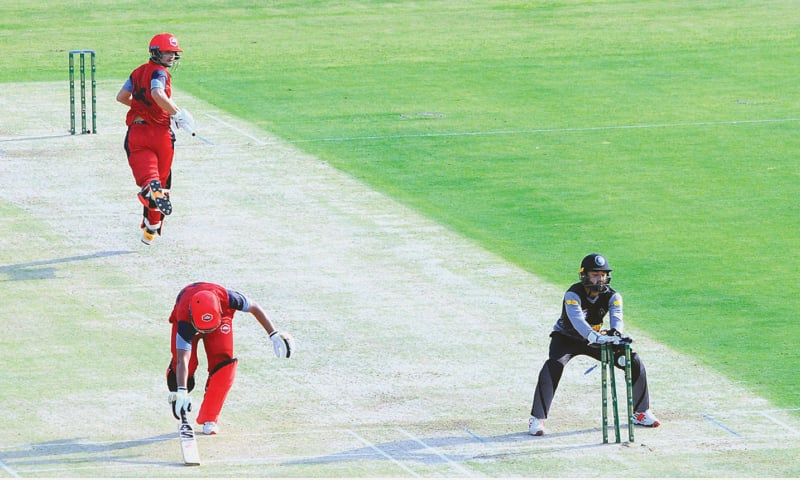 MULTAN: Northern's Haider Ali looks behind to see his batting partner Zeeshan Malik reach the crease as Khyber Pakhtunkhwa captain Mohammad Rizwan breaks the stumps during their National T20 Cup match at the Multan Cricket Stadium on Wednesday. — APP