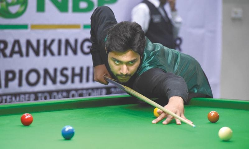 KARACHI: Haris Tahir in action against Aakash Rafique  at the 12th NBP Ranking Snooker Championship on Wednesday.—Tahir Jamal/White Star