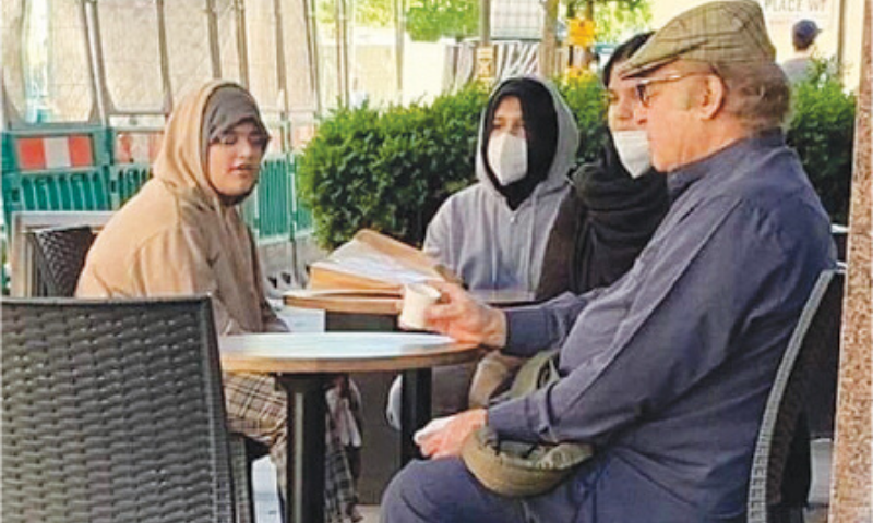 This May 2020 file photo that went viral on social media appears to show former prime minister Nawaz Sharif sitting with his granddaughters at a roadside cafe in London. — Source: Twitter/File