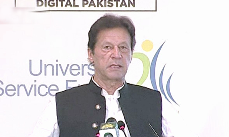 Prime Minister Imran Khan addresses a signing ceremony for the award of approximately Rs1.3 billion in contracts by the Universal Service Funds. — DawnNewsTV