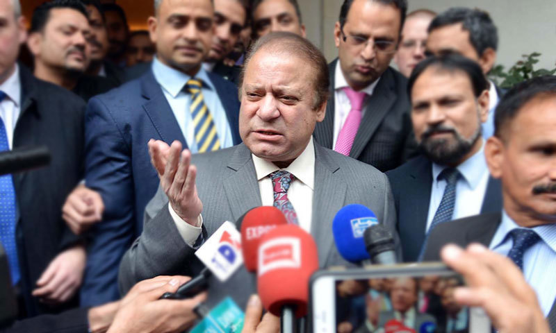 Former PM Nawaz Sharif speaks to reporters in London. — APP/File