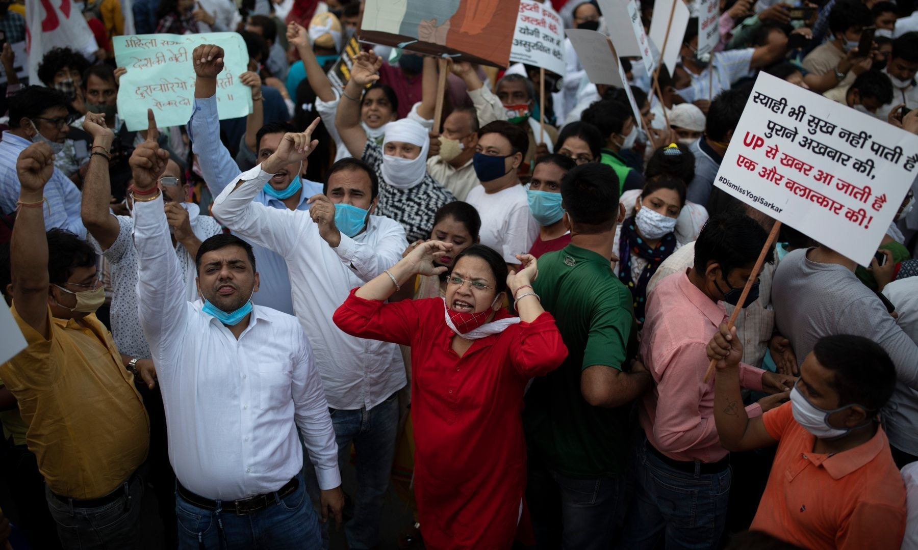 Protestors shout slogans against the gang rape and killing of a woman in India's northern state of Uttar Pradesh, in New Delhi, India, Friday. — AP