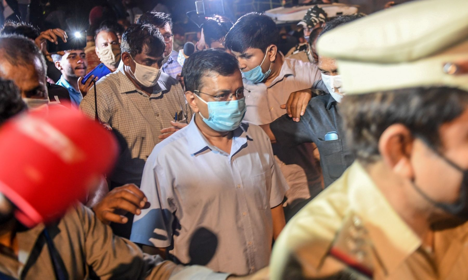 Chief Minister of Delhi Arvind Kejriwal (C) participates in a protest against the alleged gang-rape of a 19-year-old woman in New Delhi. — AFP