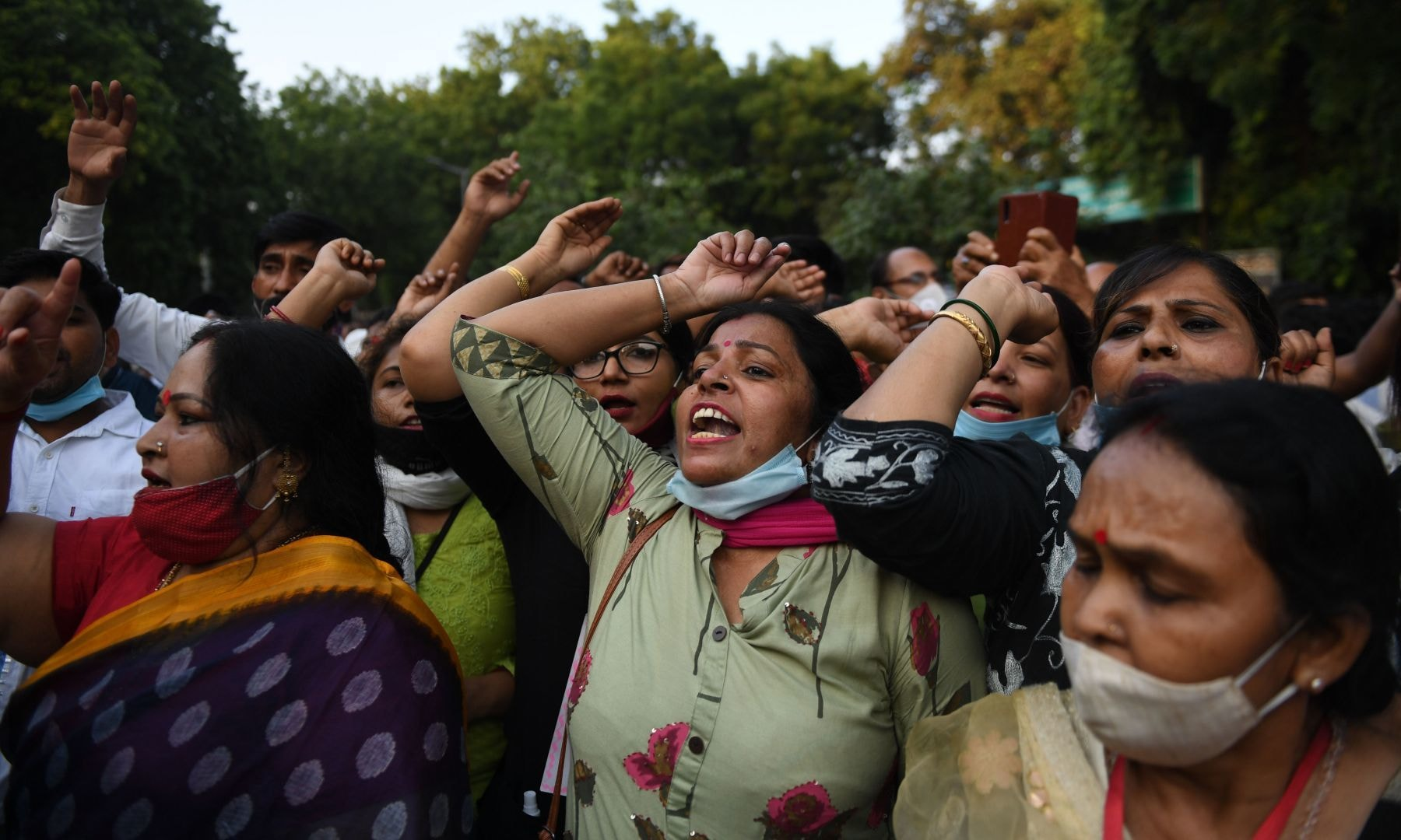 Women shout slogans during a protest against the gang-rape of a woman in New Delhi on October 2. — AFP