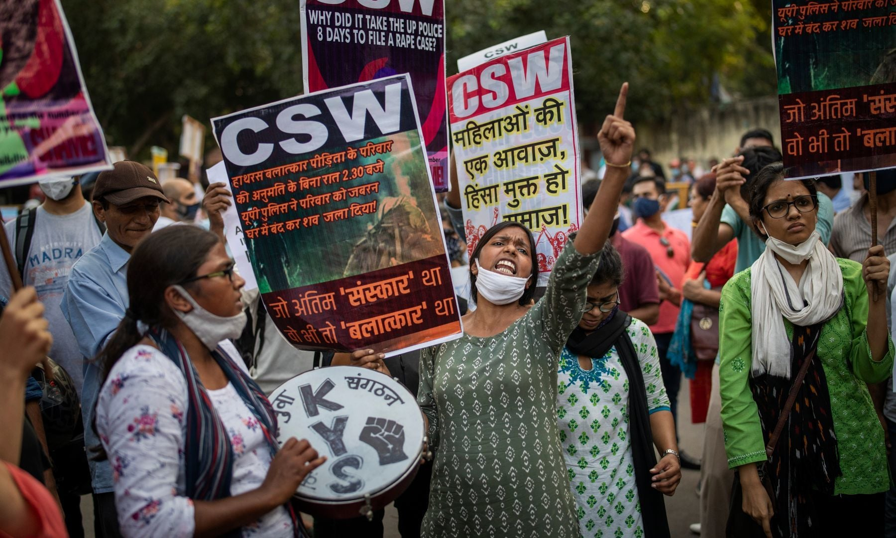 An activist shouts slogans during a protest against the gang rape of a woman in in New Delhi, India, Friday. — AP