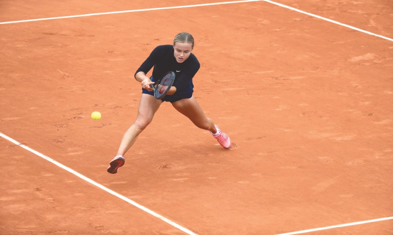 SLOVAKIA'S Anna Karolina Schmiedlova plays a shot during her third-round match against Nadia Podoroska of Argentina at the French Open on Friday.—AP