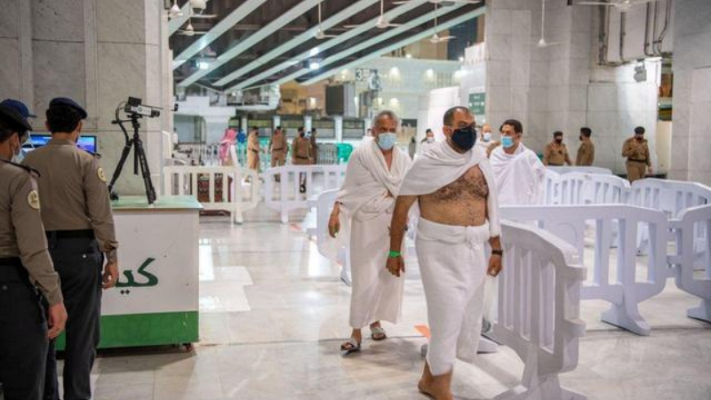 The first group of Muslims, allowed in the mosque compound by appointment, arrive at the Grand Mosque to perform Umrah, after Saudi authorities eased coronavirus  restrictions, in the holy city of Makkah, Saudi Arabia on October 3. — Reuters