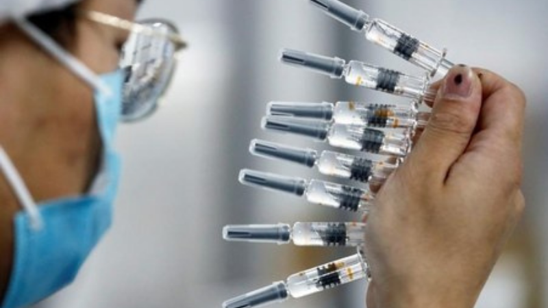 China in talks with WHO over global use of Covid-19 vaccines