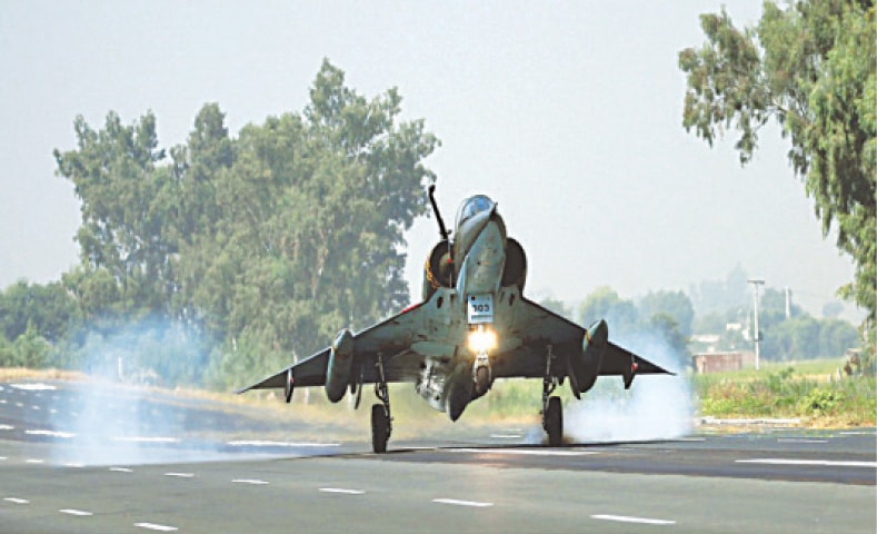 A PAKISTAN Air Force Mirage fighter lands on the motorway on Wednesday. Several PAF planes took part in the road runway operation exercise that took place on Islamabad-Lahore Motorway.—White Star