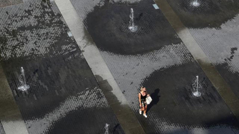 A woman walks among fountains on a square in central city during a hot summer day in Brussels, Belgium on September 16, 2020. — Reuters/File