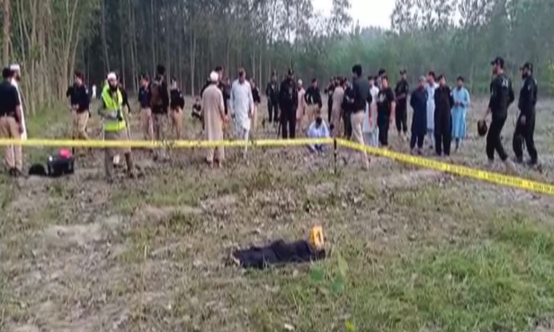 Policemen are seen at the site where the two-and-half-year-old Zainab's body was found. — DawnNewsTV
