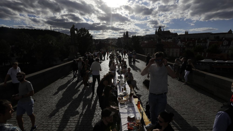 In this June 30 file photo, residents sit to dine on a 500 meter long table set on the medieval Charles Bridge, after restrictions were eased following the coronavirus pandemic in Prague, Czech Republic. — AP