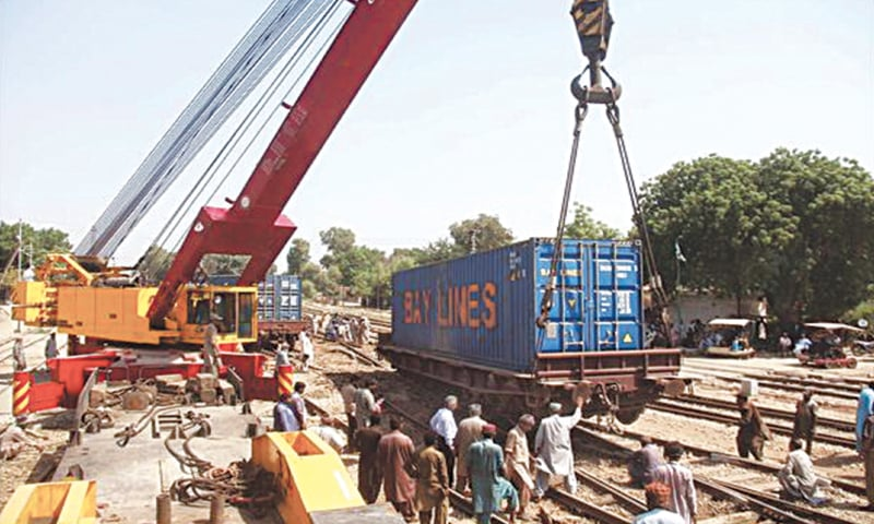 ONE of the six derailed bogies is being put back on the track with the help of a crane. — Online