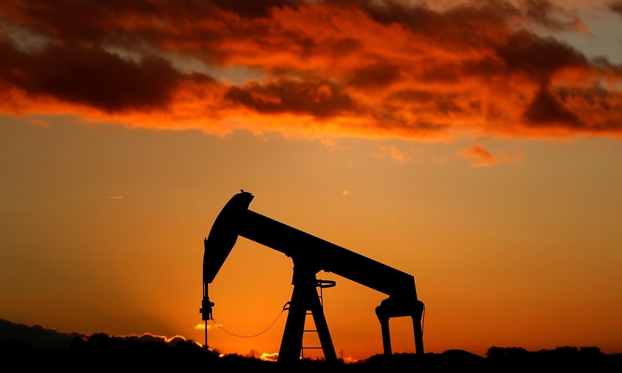 An oil pump is seen at sunset outside Scheibenhard, near Strasbourg, France. — Reuters/File