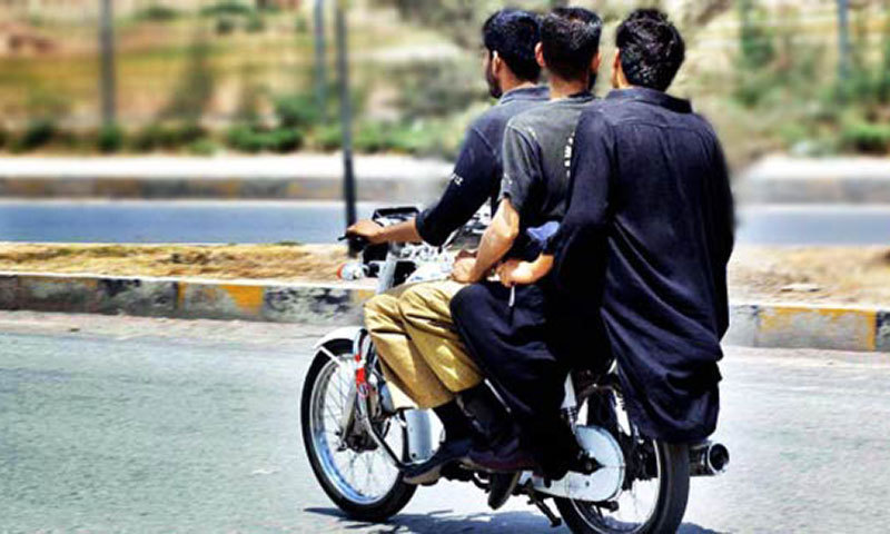 Picture shows three people riding on a bike. The Sindh government has banned pillion riding in Karachi for a month. — APP/File