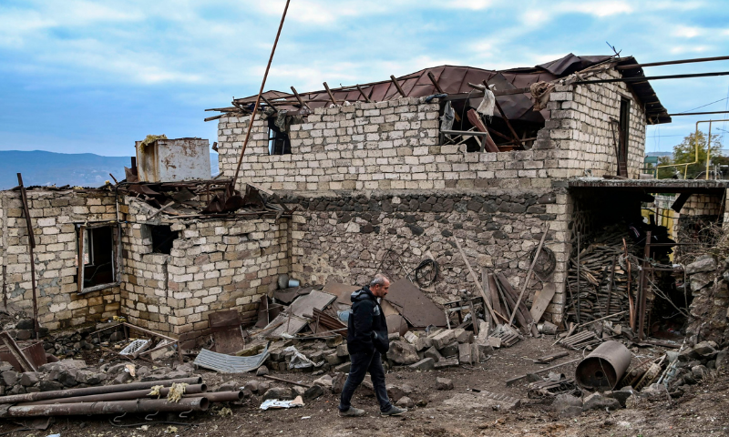 Ashot Aghajanian, 54, walks in the yard of his house, which is said was destroyed by last night Azeri shelling, in the city of Stepanakert on October 11, 2020, during the ongoing fighting between Armenia and Azerbaijan over the breakaway region of Nagorno-Karabakh. — AFP