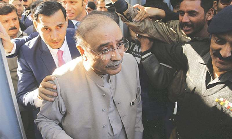 Former president Asif Ali Zardari arrives in a court for a hearing. — AP/File