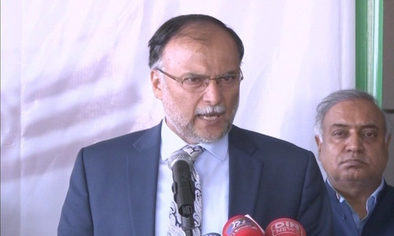 In this file photo, Ahsan Iqbal speaks to reporters in Lahore. ─DawnNewsTV