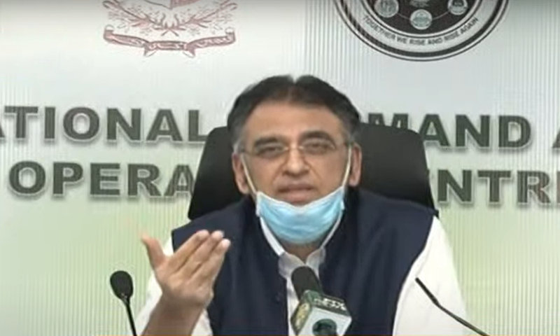 Minister for Planning and Development Asad Umar addresses a press conference after an NCOC meeting. — DawnNewsTV/File