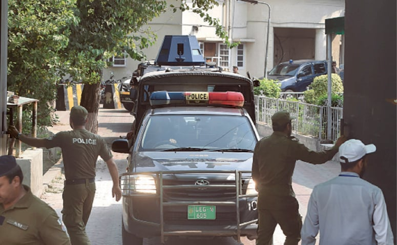 Police commandos escort a vehicle carrying the suspect in the gang-rape case as they leave the court  premises.—M Arif/White Star