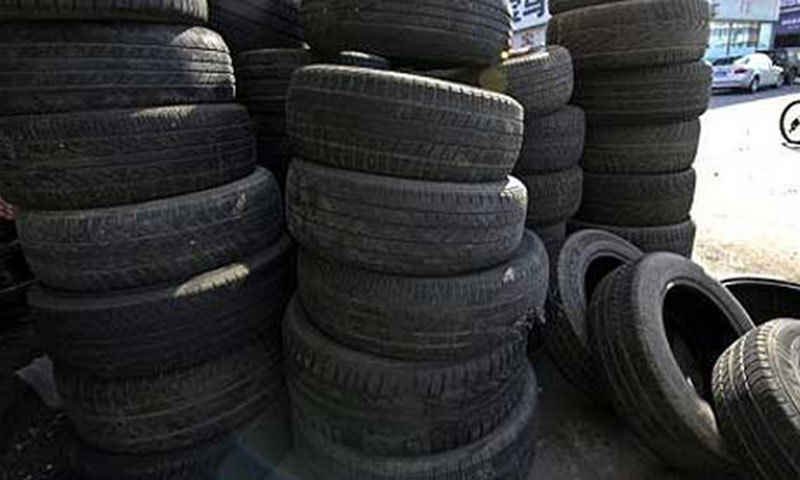 A leading tyre manufacturer has urged the government to withdraw the decision of discontinuation of stamping of goods in transit to Afghanistan. — Dawn/File