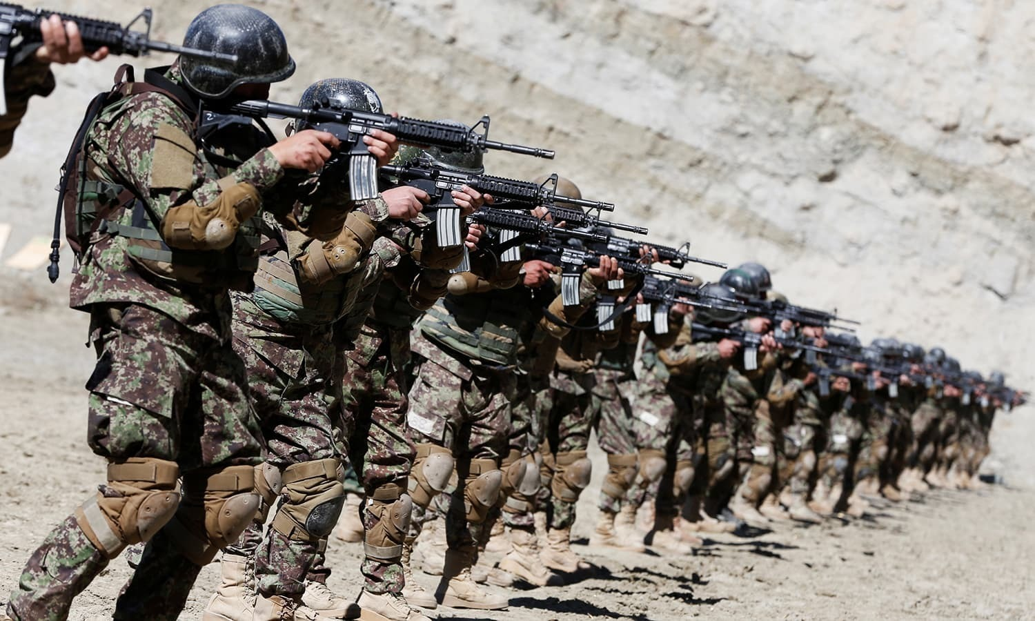 In this file photo, new recruits to the Afghan army Special Forces take part in a military exercise in Rishkhur district outside Kabul. — Reuters/File