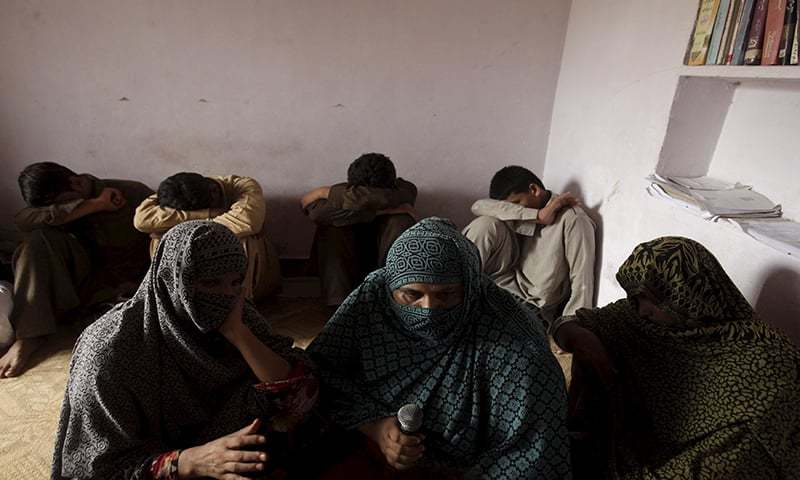Children whose families say have been abused, hide their faces while their mothers are interviewed by a Reuters correspondent in their village of Husain Khan Wala on August 9, 2015 — Reuters/File