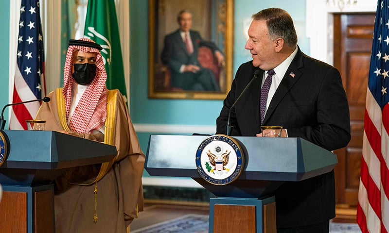 US Secretary of State Mike Pompeo (R) glances to Saudi Minister of Foreign Affairs Prince Faisal bin Farhan Al Saud as he speaks during their meeting at the State Department,  on October 14, 2020, in Washington. — AFP