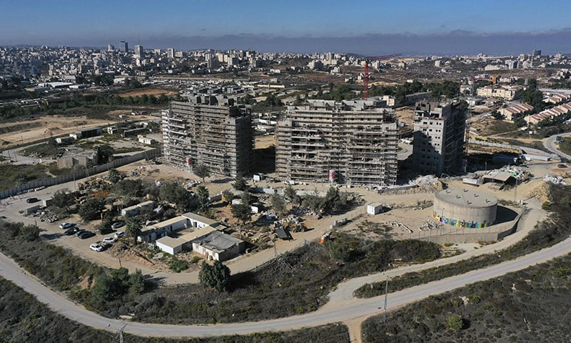 A picture taken on October 13 shows new apartments buildings under construction in the Beit El settlement in the occupied West Bank. — AFP