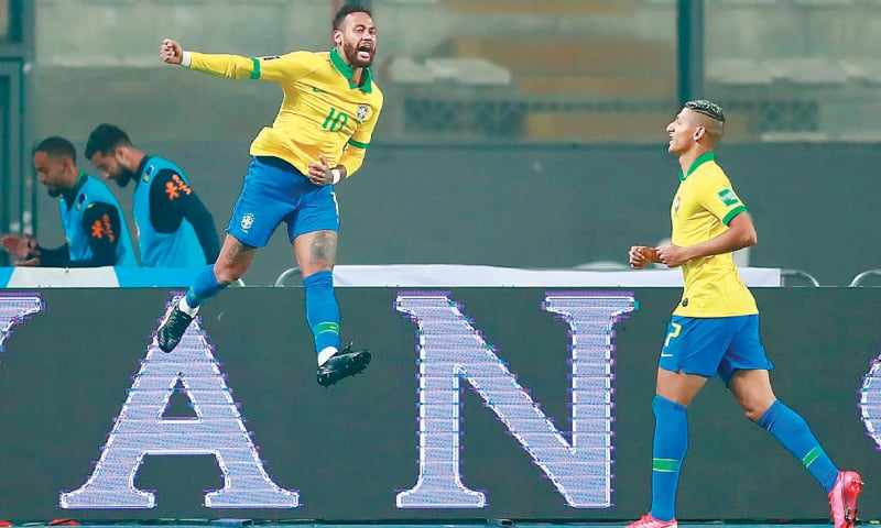 LIMA: Brazil's Neymar celebrates after scoring against Peru during their FIFA World Cup qualifier at the National Stadium.—AFP