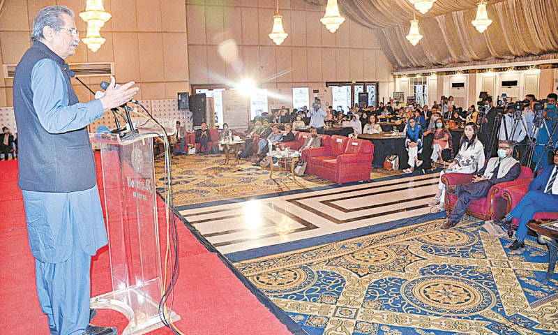 Federal Minister for Education and Professional Training Shafqat Mahmood speaks at the conference at a local hotel on Wednesday.—APP