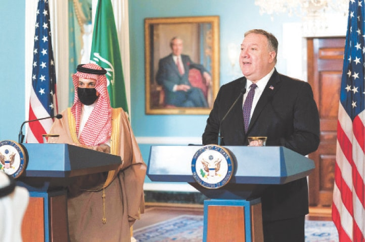 Saudi Minister for Foreign Affairs Prince Faisal bin Farhan Al Saud listens to US Secretary of State Mike Pompeo (right) during their meeting at the State Department on Wednesday.—AFP