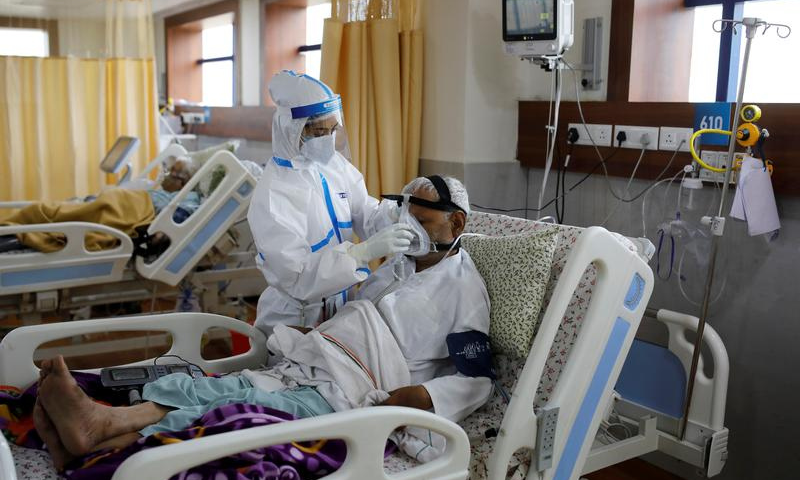 A medical worker takes care of a patient suffering from the coronavirus at the Intensive Care Unit (ICU) of the Yatharth Hospital in Noida, on the outskirts of New Delhi, India on Sept 15. — Reuters/File