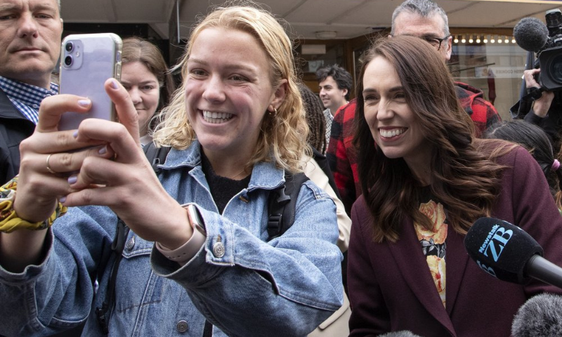 A supporter has a selfie taken with New Zealand Prime Minister Jacinda Ardern, right, in central Christchurch, New Zealand on Oct 14. — AP