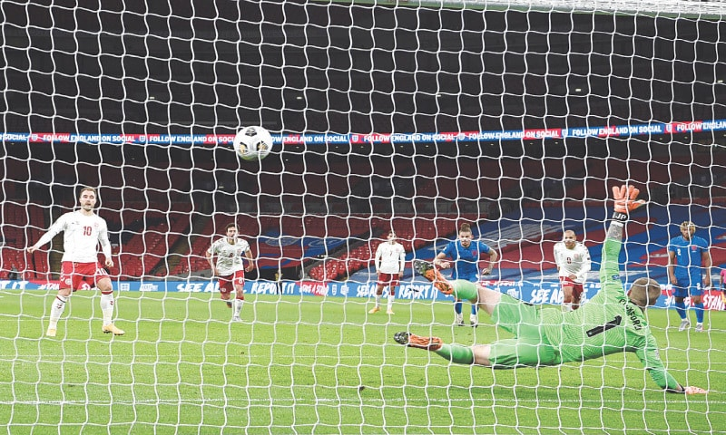 LONDON: Denmark's Christian Eriksen scores from a penalty during the UEFA Nations League match against England at Wembley.—AFP