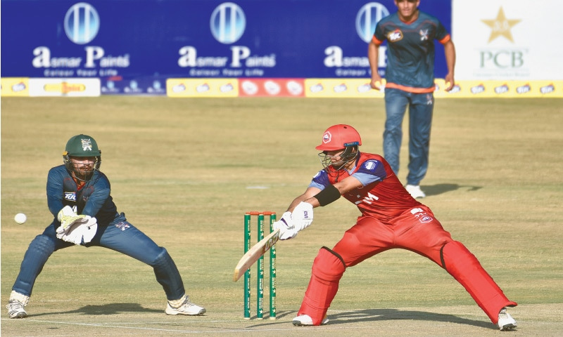 RAWALPINDI: Northern's Haider Ali attempts a late cut in his innings of 86 as Balochistan wicket-keeper Bismillah Khan looks on during the National T20 Cup fixture at the Pindi Cricket Stadium on Thursday.—Tanveer Shahzad/White Star